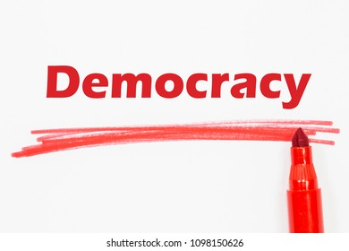 Democracy word written with red marker