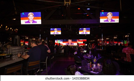 Democratic debate watch party at the abbey in West Hollywood California June 26, 2019. Senator Elizabeth Warren on the TV screens debating. Election 2020