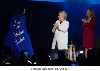 Democratic presidential nominee Hillary Clinton reacts to singer Katy Perry during a campaign rally and concert in Philadelphia, Saturday, November 5, 2016.