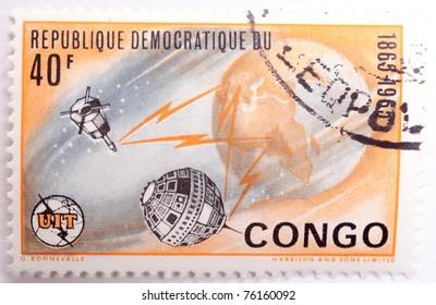 DEMOCRATIC REPUBLIC OF CONGO - CIRCA 1965: a stamp from the Democratic Republic of Congo shows image of the Earth and satellites, circa 1965