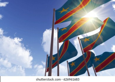 Democratic republic of Congo flags waving in the wind against a blue sky. 3D Rendering