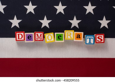 Democrats.  The word democrats spelled out on letter blocks on top of the American flag.