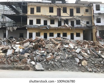 Demolish building with debris in city, broken house on ruin demolishing site after destruction