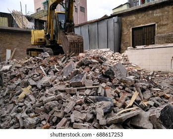 demolished concrete and brick rubble debris with excavator
