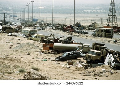 Demolished vehicles line Highway 80 the 'Highway of Death' were destroyed as Iraqi forces retreated from Kuwait during Operation Desert Storm. April 8 1991