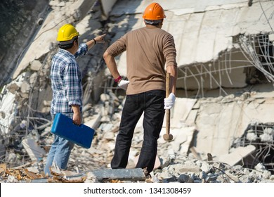 Demolition construction control supervisor or engineer architect and foreman discussing on demolish building. Worker at building site