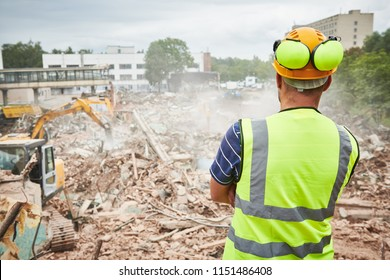 Demolition construction work. Worker at building site