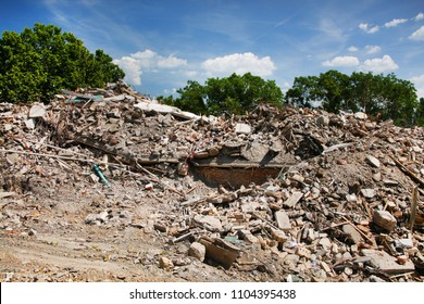 Demolition and destruction site - bricks remains and leftovers of building material on the ground