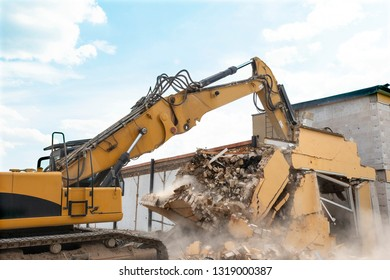demolition of a house by an excavator