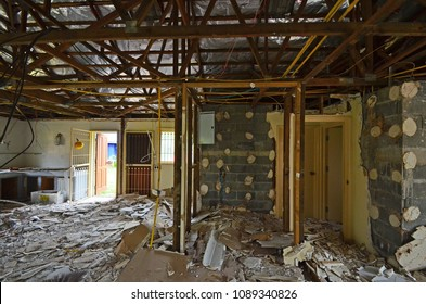 Demolition Interior Old House or Home Show Wood Structure of Roof Show Broken Ceiling and Brick Wall and Material on Floor in Construction Site