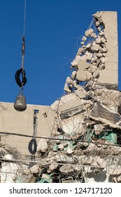Demolition, wrecking ball and what remains of a building after impact.