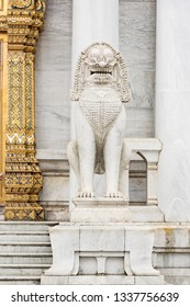Demon Lion sculpture infront of Marble temple in Bangkok