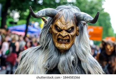 Demon mask on Halloween party. Halloween demon mask. Demon among us in Halloween. Halloween demon mask view