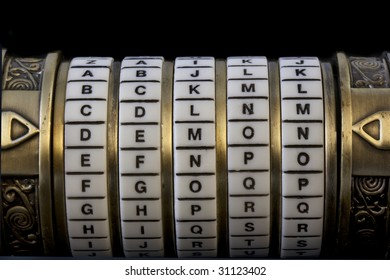 demon word set up as a password to combination puzzle box (cryptex) with rings of letters; black background