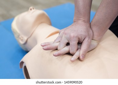 Demonstrating CPR (Cardiopulmonary resuscitation) training medical procedure on CPR doll in the class.Doctor and nurse students are learning how to rescue the patient.First aid for safe life concept.