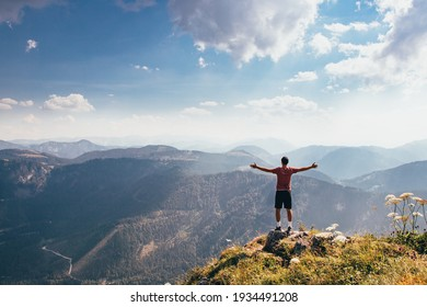 Demonstrating one's own fitness skills and self-satisfaction. A feeling of victory and fulfillment of your goal on Mount Otscher in the lower-western Austrian Alps.