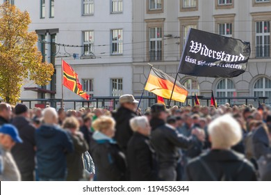 Demonstration in Germany against refugee policy . Flag with the inscription Resistance cannot be prohibited