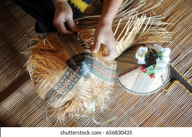 Demonstration of the making of Kadazan Papar traditional woman headdress called 'Sirung'. Sirung is made from thin sliced rattan and handwoven following the pattern pass on for generations.