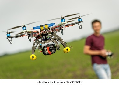 Demonstration of unmanned copter. Man quadrocopter flight controls. Zhitomir region Ukraine. 05/30/2013