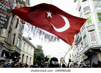 Demonstrator waves a Turkish flag during a protest to mark the 1st anniversary of the Gezi Park protests in Istanbul, Turkey on May 31, 2014