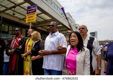 Demonstrators including labor unions and allied groups, rally at the Philadelphia International Airport during contract negotiations with American Airlines subcontractors, Thursday, July 13, 2017.