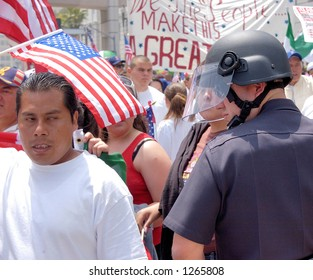 Demonstrators and LA Police Officer at illegal emigrant rally. May 1st 2006