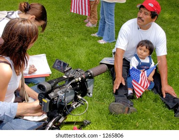 Demonstrators at Los Angeles illegal emigrant rally being interviewed, May 1st 2006