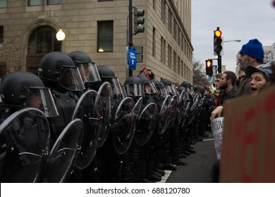 Demonstrators march, block foot traffic and clash with U.S. Capitol Police at the entry checkpoints for the Inauguration of Donald Trump, Friday, January 20, 2017.