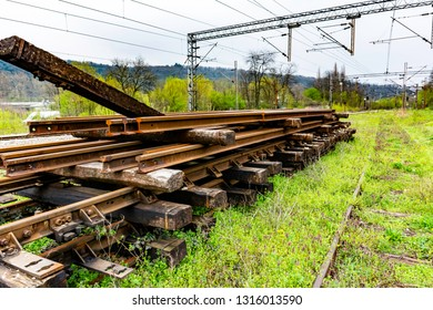 Demounted disassembled old unused railroad tracks and sleepers - Environment pollution concept