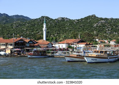 DEMRE, ANTALYA - JULY 18, 2015 : Seascape of Kekova which is an ancient Lycian region in Antalya, view of yachts and sailing boats, on bright blue sky background.
