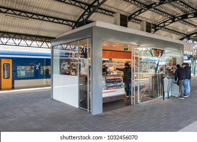 Den Bosch, The Netherlands - February 01, 2018: Customers buying drinks and sweets at kiosk in Den Bosch central train station