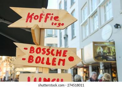 Den Bosch, Netherlands - January 17, 2015: Wooden pointer near the cafe  in the Dutch town Den Bosch.