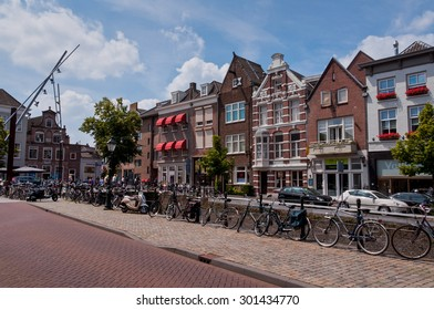 Den Bosch, Netherlands - July 6, 2013: Common street view of historical Dutch city 's-Hertogenbosch with colorful houses.