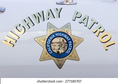 DEN BOSCH, NETHERLANDS - MAY 10, 2015: California Highway Patrol sign on a vintage US police car.