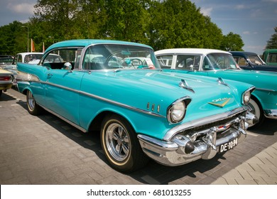 DEN BOSCH, THE NETHERLANDS - MAY 10, 2015: Turquoise 1957 Chevrolet Bel Air classic car.