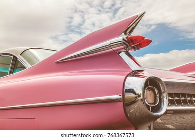 DEN BOSCH, THE NETHERLANDS - MAY 14, 2017: Rear end of a classic pink Cadillac fifties car in Den Bosch, The Netherlands