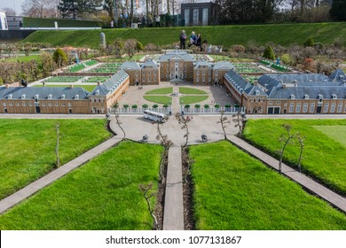 Den Haag, Netherlands - April 8, 2018: Madurodam miniature museum park is a famous attraction. Mini human figures, cars, buildings, trains, bridges, ships and a garden of giant tulips await tourists.