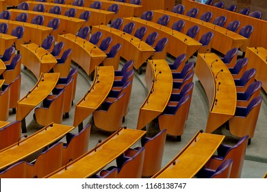 Den Haag, The Netherlands - August 29, 2012: Interior detail of the empty plenary hall of the House of Representatives in The Netherlands with the chairs for the people's representatives