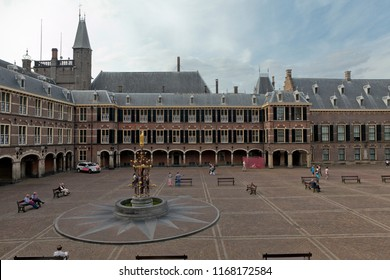Den Haag, The Netherlands - August 29, 2012: Main square called Binnenhof with historic parliament buildings and House of Representatives of The Netherlands in The Hague