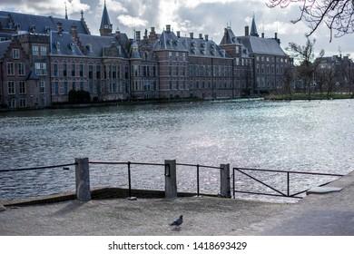 Den Haag, Netherlands, Europe, Binnenhof, BUILDINGS BY RIVER AGAINST SKY IN CITY