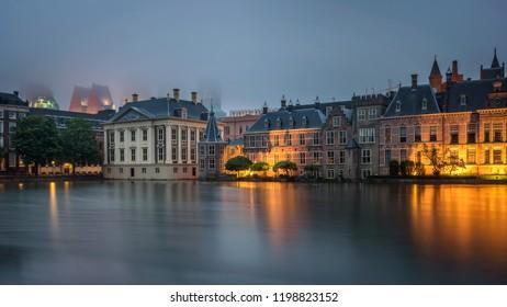 DEN HAAG, NETHERLANDS - JUNE 1, 2018 : Dutch Parliament Building , Mauritshuis art museum and the court building complex Binnenhof located in the City of Den Haag, Netherlands. Long exposure.