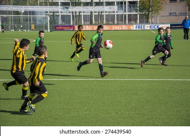 DEN HAAG, THE NETHERLANDS, MAY 02-05-2015 - kids from the soccer club Haagse voetbal vereniging RAS are playing a match against Duno. The children from the club RAS won the game.