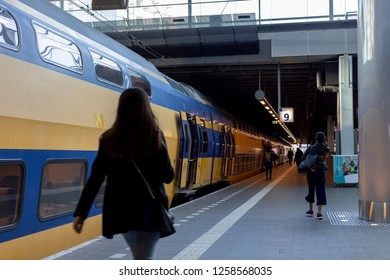 Den Haag, The Netherlands - November 14th 2018: Train platform with an intercity train waiting to transport the people that arrive in a Dutch railway station