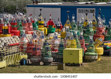 Den Helder, Holland - 26th May 2011: A Store for all sorts of different buoys of many Colours at Den Helder Port. These Buoys are ready for Maritime use when needed.