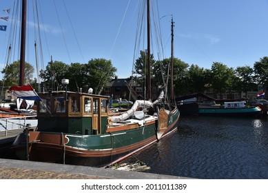 Den Helder, the Netherlands - 87 July 2021. Old boats and a buoy at 'Willemsoord', the former shipyard of Den Helder.