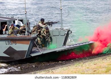 DEN HELDER, THE NETHERLANDS - JULY 7: Dutch Marines in a Landing craft during an amphibious assault demo during the Dutch Navy Days on July 7, 2012 in Den Helder, The Netherlands