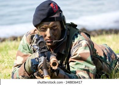 DEN HELDER, THE NETHERLANDS - JULY 7: A Dutch Marine during an amphibious assault demo during the Dutch Navy Days on July 7, 2012 in Den Helder, The Netherlands