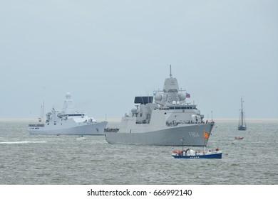 "DEN HELDER, NETHERLANDS - June 25, 2017:  Marine Festival ""SAIL"", dutch title ""Marinedagen"" 2017 - view on boats taking part in the event - maneuver of modern defense ships meet historic tall ships"
