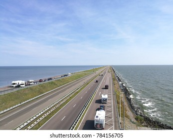 DEN OEVER; THE NETHERLANDS - AUGUST 14, 2017: The Afsluitdijk  is a major causeway in the Netherlands, constructed between 1927 and 1932 over a length of 32 kilometres (20 mi) and a width of 90 metres