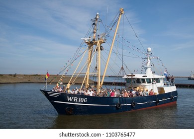 DEN OEVER, THE NETHERLANDS – AUGUSTUS 28, 2018: Fishing day event a Netherlands festival at the fishing village Urk for promoting the fishing industry on the waddensea